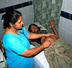 Examination of a pregnant woman in Malipur Maternity Home, Delhi, India